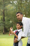 Indian father and son playing Royalty Free Stock Photography