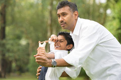 Indian father and son playing Royalty Free Stock Image