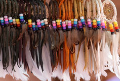 Indian feathers. American Indian handicrafts made with colorful feathers Royalty Free Stock Photo