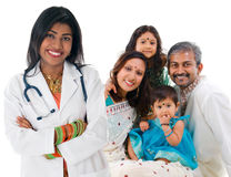 Indian female medical doctor and patient family. Smiling friendly Indian female medical doctor and patient family. Health care concept. Isolated on white stock images