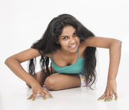 Indian female model posse in studio white background Stock Photos