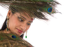 Indian female with peacock feathers. Stock Images