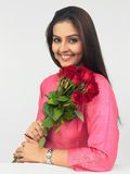 Indian female with roses Royalty Free Stock Photos
