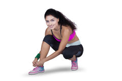 Indian female runner tying her shoelaces Stock Image
