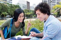 Indian female student learning with friend. Outdoors on campus of the university Stock Photography