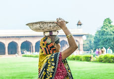Indian female worker carry stones Stock Images