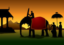 Indian festival. Silhouettes of an elephant and people at an Indian temple festival at sunset Royalty Free Stock Image