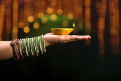 Indian Festival Diwali, lamp in hand royalty free stock image