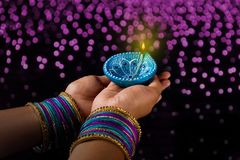 Indian Festival Diwali, lamp in hand stock photography