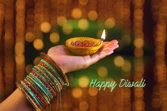 Indian Festival Diwali, lamp in hand royalty free stock images
