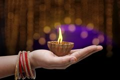 Indian Festival Diwali, lamp in hand royalty free stock photos
