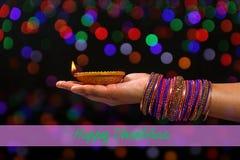 Indian Festival Diwali, lamp in hand stock photo