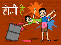 Indian festival, Holi celebration with kids. Indian festival celebration with cute little boys playing colors and Hindi text Holi Hai (Its Holi Stock Images