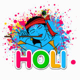 Indian festival, Holi celebration with Lord Krishna. Royalty Free Stock Images