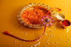 Indian festival raksha bandhan , Rakhi with flower ,rice. Indian festival raksha bandhan , Rakhi with flower , rice etc stock photo