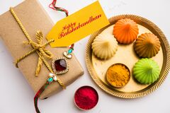 Free Indian Festival Raksha Bandhan With Rakhi Bracelets, Presents, Rice And Kumkum In Bowls. Copy Space Stock Photos - 190919273