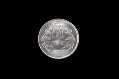 Indian fifty paise coin close up on black. An extreme close up of an Indian fifty paise coin on a solid black background Royalty Free Stock Image