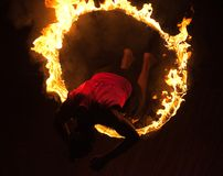 Kalaripayattu Martial Art in Kerala, India. Indian fighter jumping through the fire hoop during Kalaripayattu marital art demonstration. Kalaripayattu is an Royalty Free Stock Photo