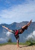 Indian fighter performing outdoors Kalaripayattu training in Ker Royalty Free Stock Photography
