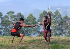 Indian fighters performing Kalaripayattu Marital art demonstration in Kerala, India. Indian fighters performing Aayudha Payattu Weapon Combat during royalty free stock photos