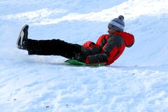 Indian for the first time riding a sled. stock image
