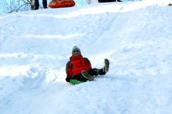 Indian first time sledding. stock image