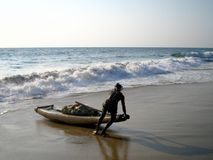 Indian Fisherman. Fisherman coming back with a catch of fish on the beach in Kerala, India Royalty Free Stock Photos