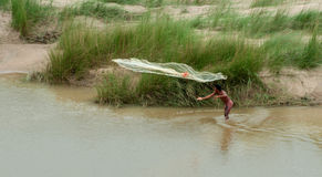 Indian fisherman fishing on river Royalty Free Stock Photography