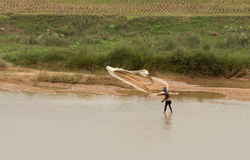 Indian fisherman fishing on river Royalty Free Stock Photos