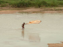 Indian fisherman fishing on river Royalty Free Stock Image