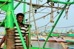 Indian fisherman on his boat in Kanyakumari, India Stock Photo