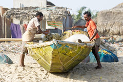 Indian fisherman near the boat and nets Stock Images