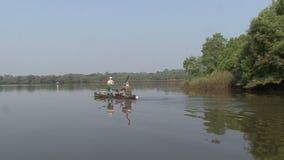 Indian fisherman river stock video