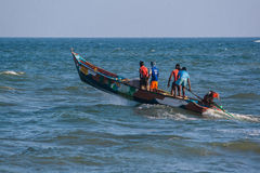 Indian fishermen on the boat Royalty Free Stock Photography