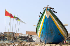 Indian fishermen boat and village Royalty Free Stock Images