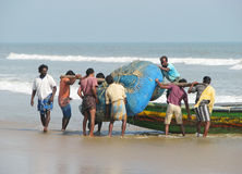 Indian fishermen are carrying the nets Stock Photography