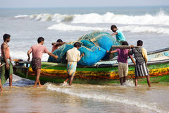 Indian fishermen are carrying the nets Royalty Free Stock Photography