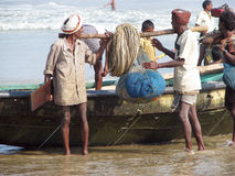 Indian fishermen are carrying the nets Stock Photo