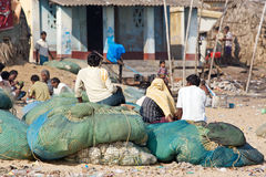 Indian fishermen and nets Royalty Free Stock Photo