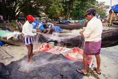 Indian fishermen on the sea beach Royalty Free Stock Photo