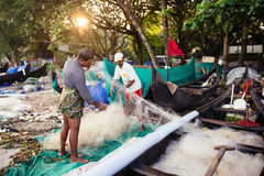 Indian fishermen on the sea beach Stock Images