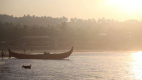 Indian fishermen in silhouette at sunrise stock video