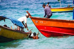 Indian fishermen on their boats in the ocean royalty free stock images