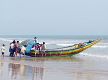 Indian fishermen and traditional boat Stock Photos
