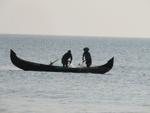 Indian Fishing Boat in Sea. Two Fishermen sitting on a Indian Fishing Boat in Sea Stock Photography