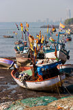 Indian fishing boats. Waiting for the tide to come in at this boat landing on the west side of Colaba, Mumbai Stock Photography