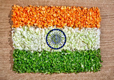 Indian flag from chopped vegetables. Indian national flag from chopped raw vegetables: carrot, cabbage and green beans on the textured table represent pure stock image
