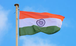 Indian Flag. Fluttering in blue sky stock photos