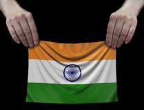 Indian flag in hands. Image of Indian flag in hands stock image