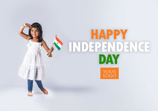 Indian flag and people. Cute little indian girl holding indian flag stock photo